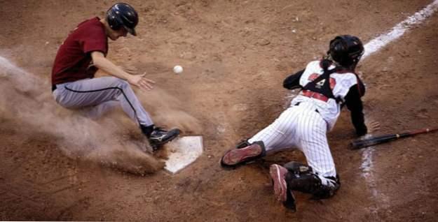 Hráči baseballu s velkými kohouty